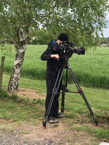 Camera man filming at Peacocks UK